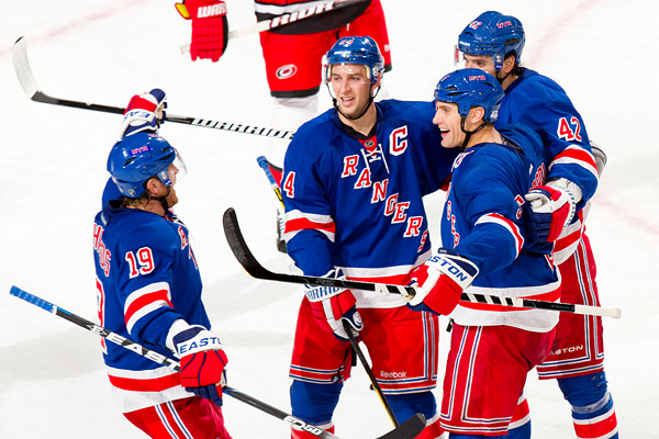 With the game tied at 1-1, the Rangers unleashed a fury of shots (17) in the third period, leading to goals by Dan Girardi (right, #5)