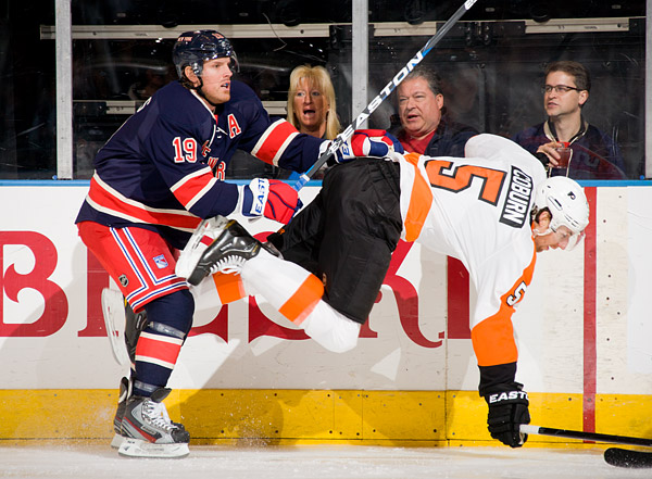 The Rangers' Brad Richards gives the Flyers' Braydon Coburn a gentle shove