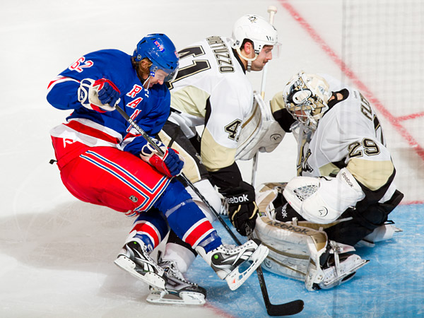 Hagelin rushes the net, stopped by Pittsburgh defenseman Robert Bortuzzo and goalie Marc-Andre Fleury