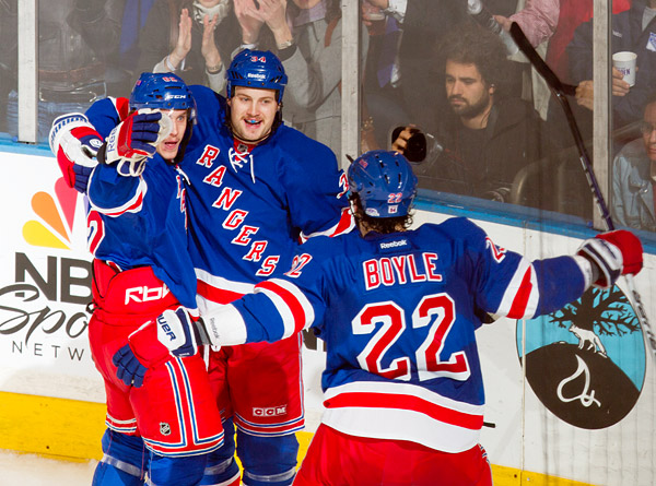 Mitchell celebrates his second period goal with Ranger teammates Carl Hagelin and Brian Boyle