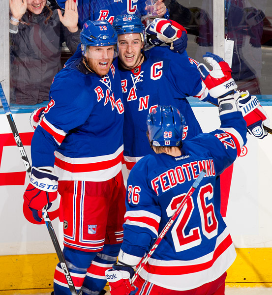 New York's Brad Richards (left) celebrates his goal with team captain Ryan Callahan and teammate Ruslan Fedotenko, who earned assists on the play