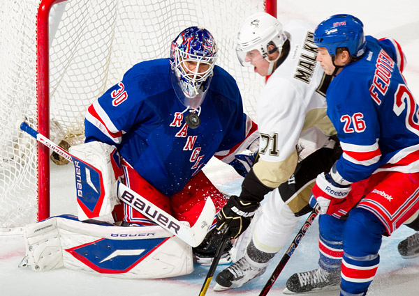 Rangers goalie Henrik Lundqvist makes a big save against Pittsburgh's Evgeni Malkin. Lundqvist has been superb this season with a .933 save percentage and 2.1 goals against average