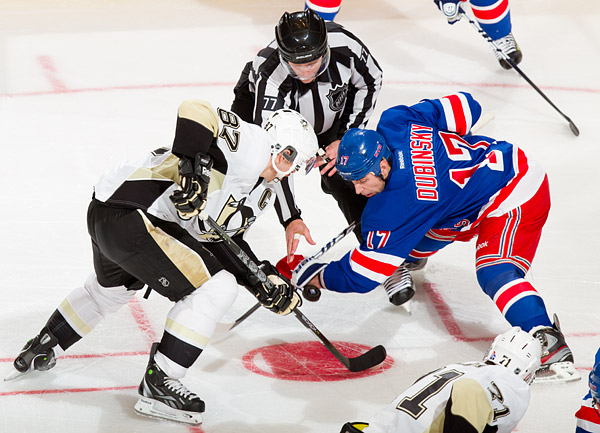 Penguin Sidney Crosby faces off against Ranger Brandon Dubinsky