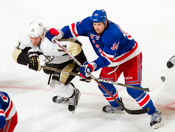 Pittsburgh's Jordan Staal and New York's John Mitchell