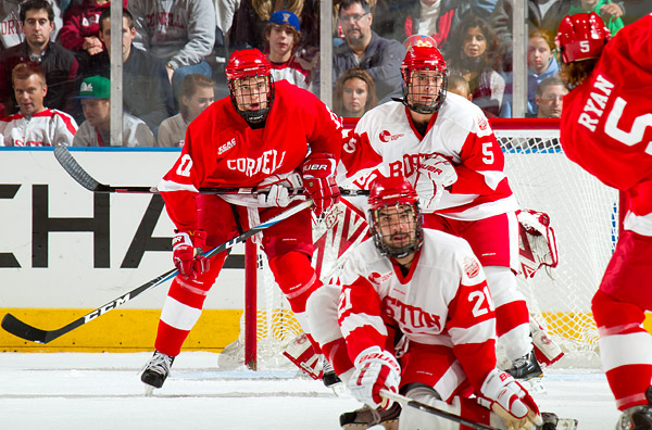 Cornell's Brian Ferlin (#17) sets up in front of the net while BU defensemen Adam Clendening (#5) and Sean Escobedo (#21) attempt to block a shot by Joakim Ryan