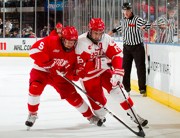 Cornell's Joakim Ryan and BU's Justin Courtnall