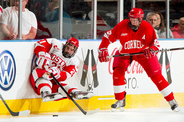 BU defenseman Sean Escobedo keeps the puck from Cornell's Sean Collins