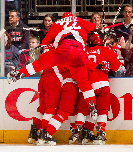 The Cornell Big Red celebrate Locke Jillson's late game-tying goal