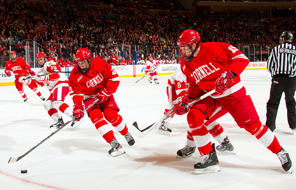 Cornell's Erik Axell (#21) and Sean Whitney (#19)