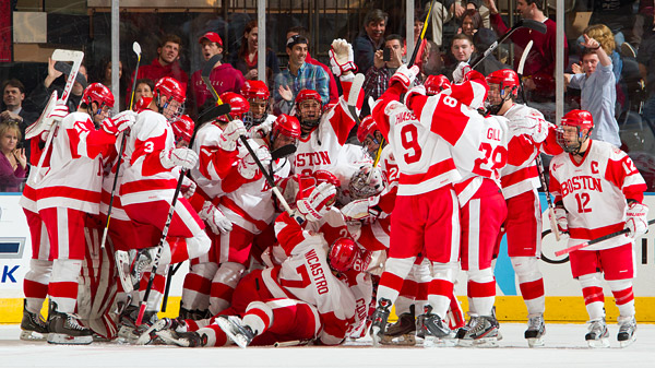The Boston University Terriers celebrate their 2-1 overtime victory. The win improves their Madison Square Garden Red Hot Hockey record to 2-0-1.