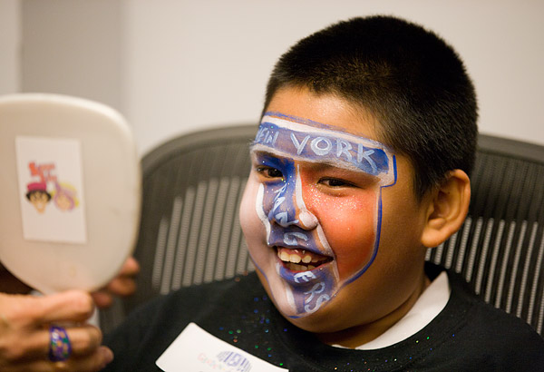 A proud Team Tortorella player gets his face painted to show his team spirit