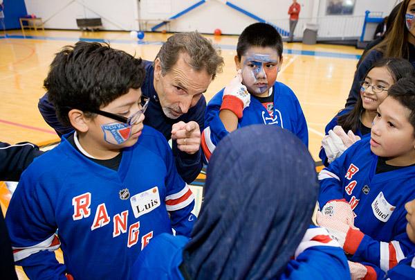 Coach Tortorella strategizes with his team