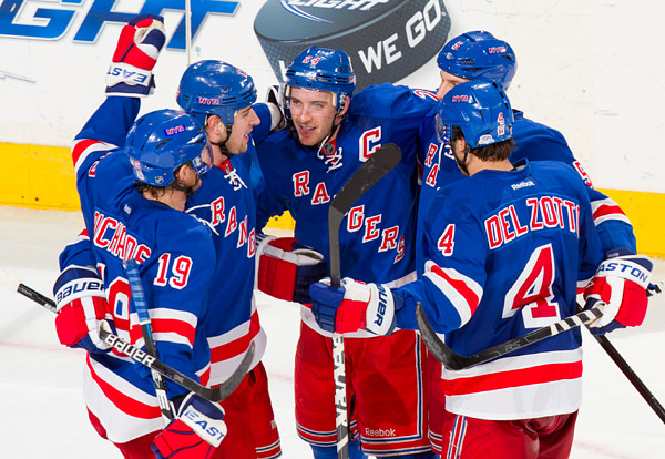 Rangers captain Ryan Callahan celebrates his goal with teammates late in the third period, giving them a 4-1 lead