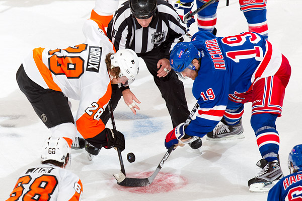 Philadelphia's Claude Giroux faces off against New York's Brad Richards