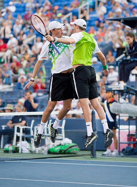 Bob and Mike Bryan celebrate a doubles victory at the 2010 US Open