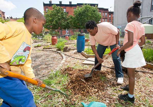 Planting in Brooklyn's Greene Acres Community Garden