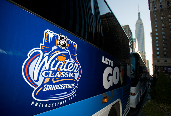 One of several buses (with the iconic Empire State Building in the background) ready to transport Rangers fans from New York to Philadelphia for the game