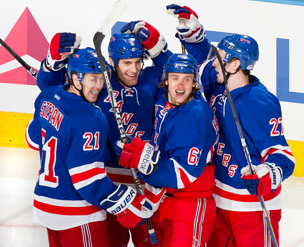 New York's Dan Girardi (second from left) celebrates his first period goal with teammates Derek Stepan, Carl Hagelin and Ryan McDonagh