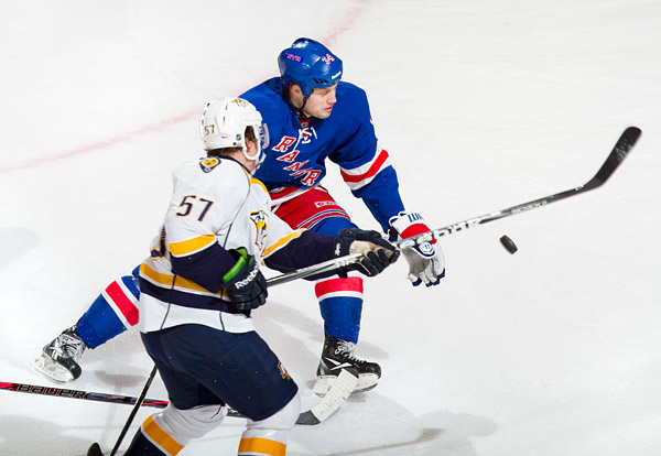 The Rangers' John Mitchell, who scored the team's second goal, defends against the Predators' Gabriel Bourque