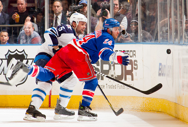 Rangers captain Ryan Callahan battles for the puck with Jets defenseman Mark Stuart