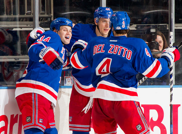 New York's John Mitchell (left) celebrates his goal with teammates Artem Anisimov and Michael Del Zotto