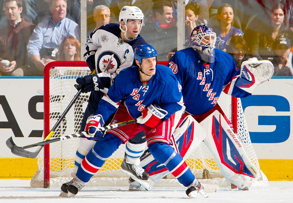 Rangers defenseman Dan Girardi and goalie Henrik Lundqvist protect the net against Jets captain Andrew Ladd