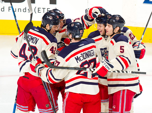 New York's Artem Anisimov celebrates his early first period goal with teammates