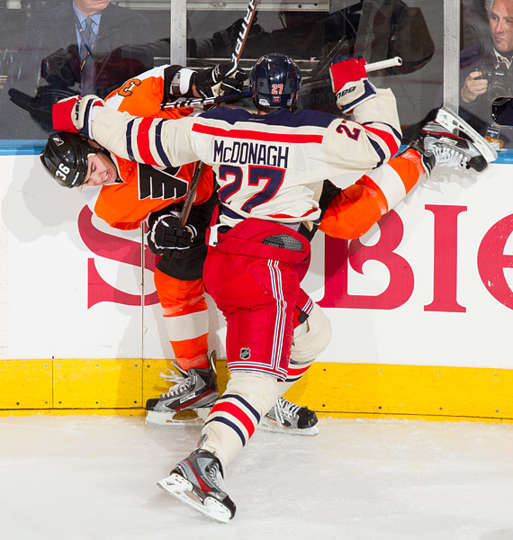 New York's Ryan McDonagh checks Philadelphia's Zac Rinaldo