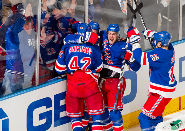 Michael Del Zotto and the Rangers celebrate their overtime win over the Lightning