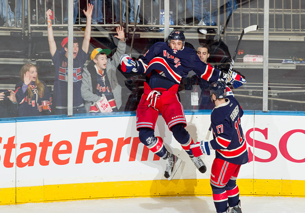 Artem Anisimov jumps in celebration after scoring his second-period goal