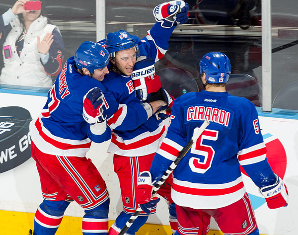 Rangers captain Ryan Callahan celebrates his overtime goal with teammates Brandon Dubinsky and Dan Girardi