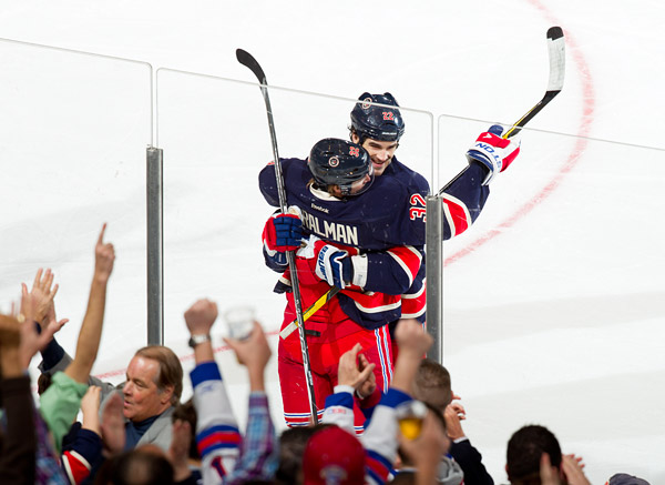 Brian Boyle and Anton Stralman celebrate a goal