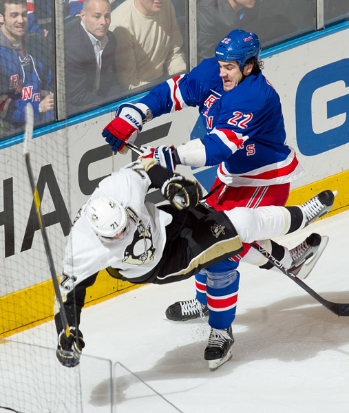 New York's Brian Boyle levels Pittsburgh's Evgeni Malkin