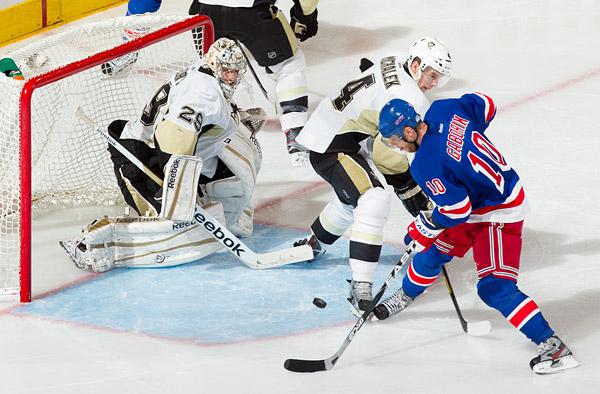 The Rangers' Marian Gaborik attempts to score against Penguins goalie Marc-André Fleury and defenseman Zbynek Michalek