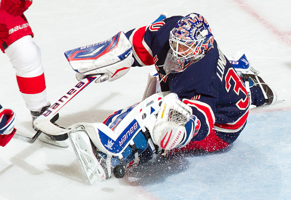 Rangers goalie Henrik Lundqvist makes one of 26 saves