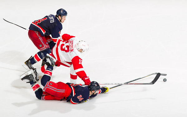 New York's Ryan Callahan and Michael Del Zotto stop a late breakaway by Detroit's Pavel Datsyuk