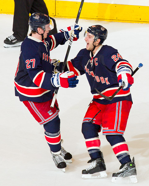 Ryan Callahan celebrates his overtime goal with Ryan McDonagh and the rest of the Rangers