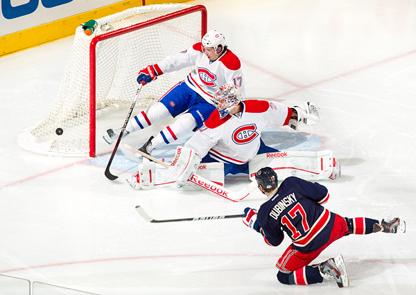New York's Brandon Dubinsky shoots on Montreal goalie Carey Price and defenseman Chris Campoli