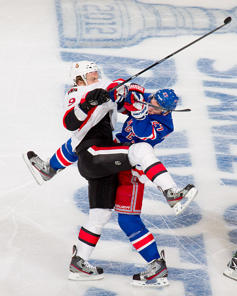 New York's Ryan McDonagh gets physical with Ottawa's Milan Michalek