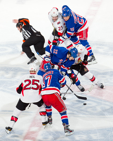 New York's Brian Boyle faces off against Ottawa's Jim O'Brien