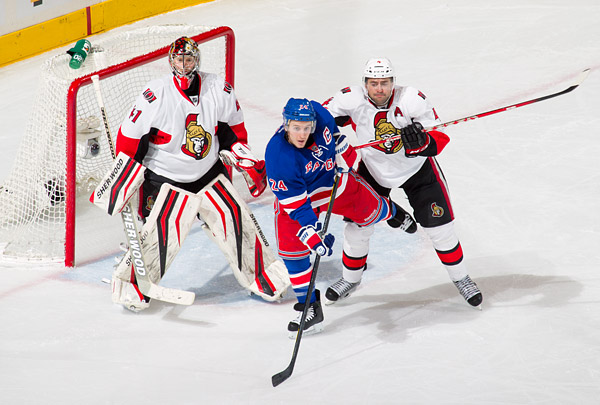 Rangers captain Ryan Callahan sets up in front of Senators goalie Craig Anderson and defenseman Chris Phillips