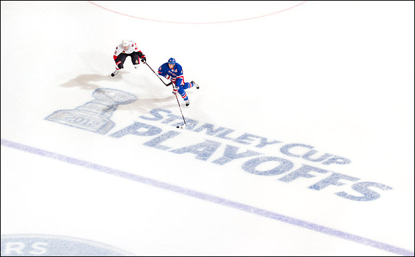 The New York Rangers' Marc Staal skates past the Ottawa Senators' Jim O'Brien in the opening round of the Stanley Cup Playoffs