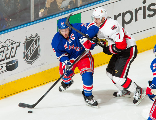 New York's Ryan Callahan works the puck against Ottawa's Kyle Turris