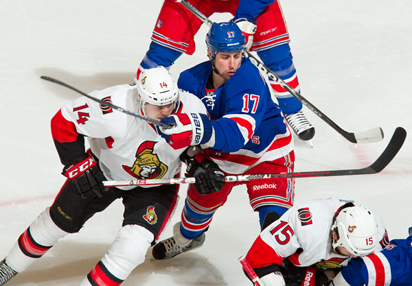New York's Brandon Dubinsky gets in the face of Ottawa's Colin Greening