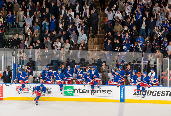 The Garden crowd erupts and the Rangers storm off the bench after the final buzzer seals the series victory