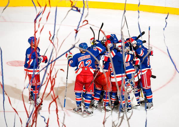 The New York Rangers celebrate in a sea of confetti after defeating the Ottawa Senators in Game 7 to advance to the Stanley Cup Eastern Conference Semifinals