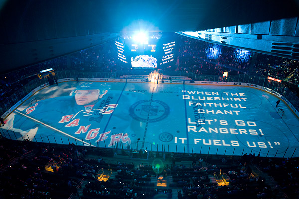 The Rangers project an opening sequence on the ice before the start of the game