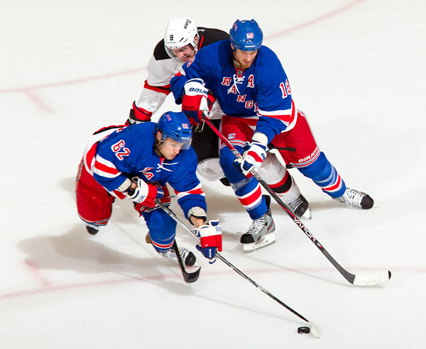 New York's Carl Hagelin, Marc Staal, and New Jersey's Zach Parise