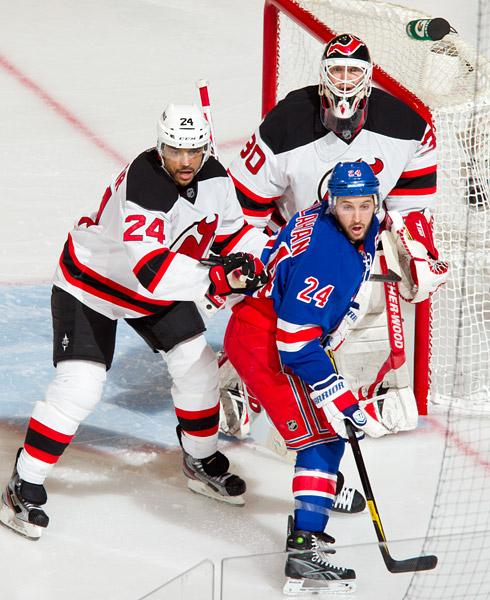 Rangers captain Ryan Callahan sets up in front of Devils defenseman Bryce Salvador and goalie Martin Brodeur