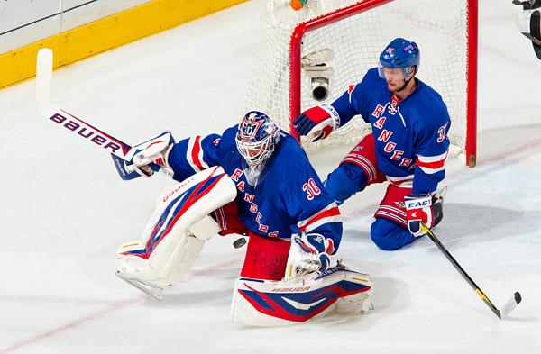Rangers goalie Henrik Lundqvist makes a save with support from defenseman Anton Stralman